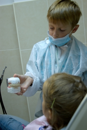 8 years old boy wants to be an orthodontist. Choosing a profession photo