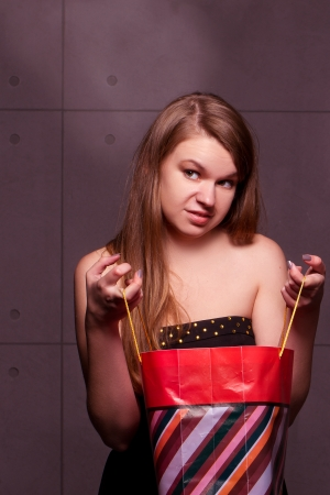 The beautiful fashionable young woman considers gifts