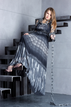 girl in a long dress sitting on stairs Stock Photo - 23179497