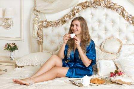 Morning coffee or tea in bed Stock Photo - 23421144