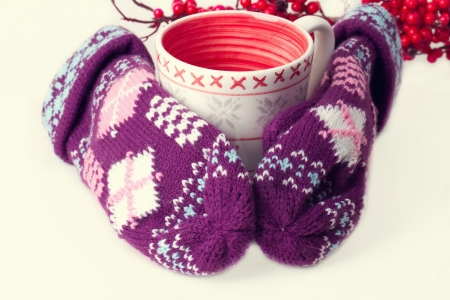 the chosen one: Cozy red gloves hold a mug of hot cocoa Stock Photo