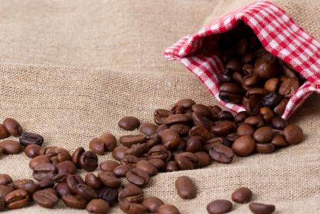 Coffee beans in sack,  burlap Stock Photo - 23552218