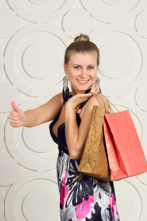 Happy woman holding shopping bags and smiling photo