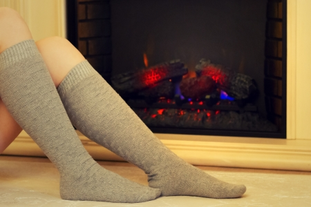 Female feet in socks on a background of fire photo