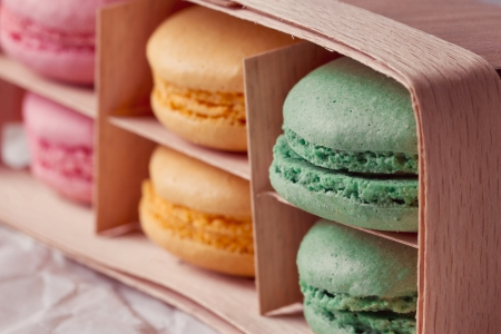Multicolored macaroon in a box with three compartments
