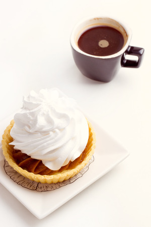 Cake with whipped cream and black coffee photo