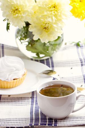 Romantic breakfast. Tea, cake, yellow chrysanthemum photo