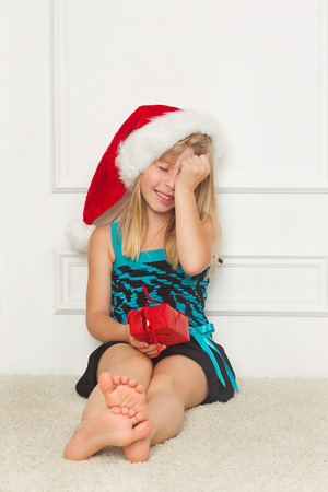 little girl in the santa claus hat photo
