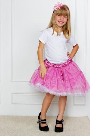 girl in a pink dress. studio shot Stock Photo