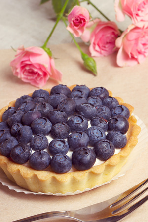 blueberry pie: Blueberry pie and berries on rustic wooden table