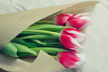 multiples: Bouquet of red tulips in multiples of parchment Stock Photo