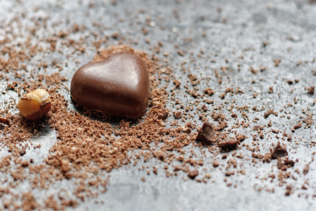 chocolate chips: Chocolate heart in chocolate chips on a black background