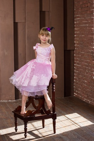 6 years girl: Girl 6 years old sitting on a high chair