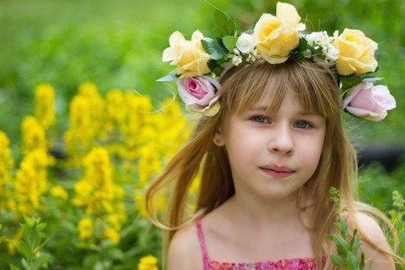 6 years girl: Girl 6 years old in a wreath in the meadow Stock Photo
