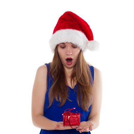 Girl in Christmas hat gift upset. On a white background. isolate