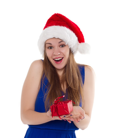 rejoice: girl in a Christmas cap gift to rejoice on white background.