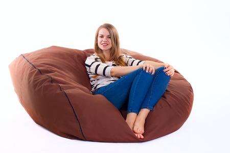 beanbag: cute girl sitting on a braun beanbag chair.