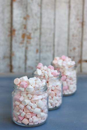 marshmellow: Three glass jars filled to the brim marshmallow Stock Photo