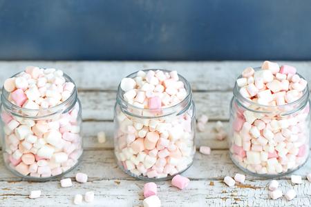 Three glass jars filled to the brim marshmallow Stock Photo