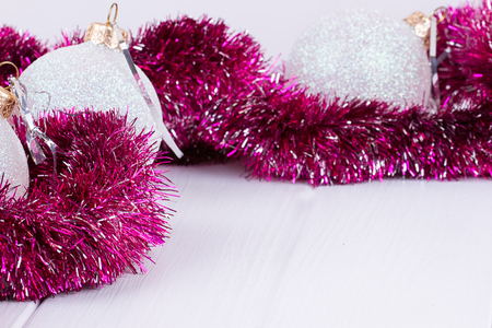 Christmas card with white balls and purple garlands