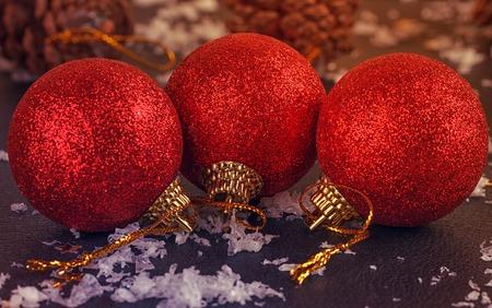 red satin Christmas balls on black background Stock Photo