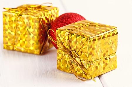 Christmas decorative gift box, ball on white background Stock Photo