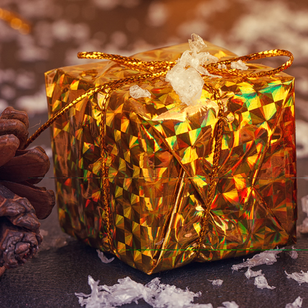 Gold box with gifts. On black background Stock Photo