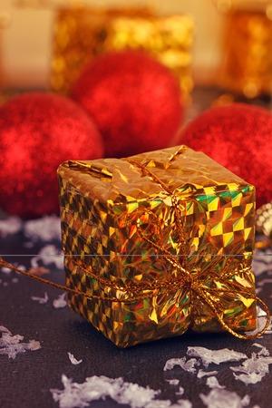 Christmas decorative gift box, ball on black background