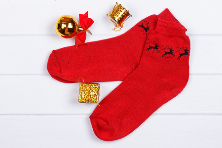Christmas red socks on a white wooden background