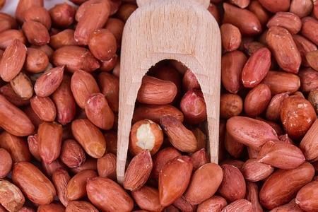 roasted peanuts with spatula close up photo