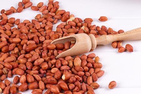 junk: roasted peanuts with spatula close up photo