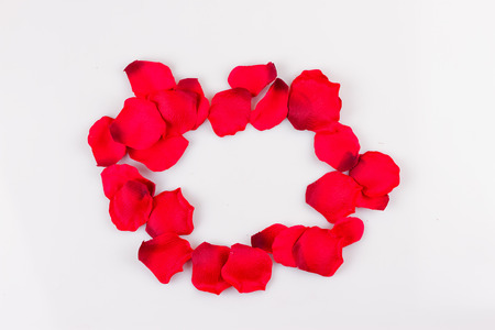 Frame of artificial rose petals on the white background Stock Photo