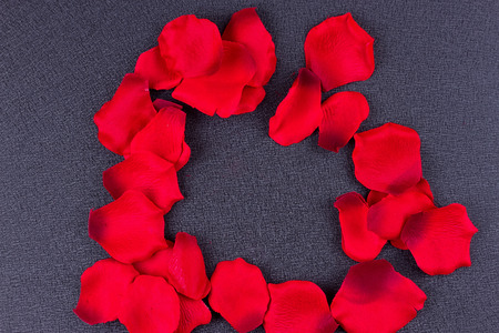 Artificial petals red roses black background frame Stock Photo