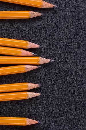 erased: set of pencils on black background, closeup, macro