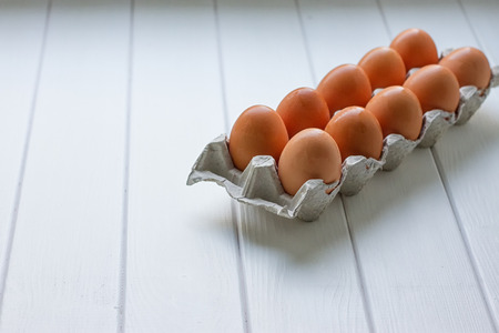eggtray: Eggs in the paper tray package on white background.
