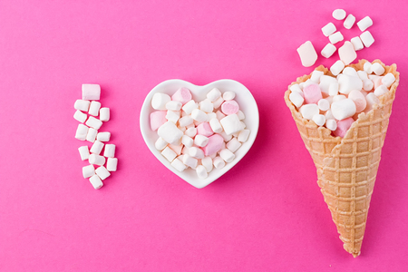 love declaration: Love concept. Plate in the shape of heart with a marshmallow on a pink background. I love Stock Photo
