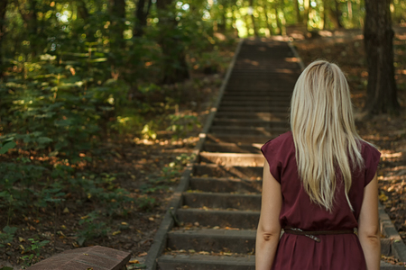 woman going up the stairs in the park