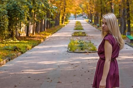 girl d on the autumn alley