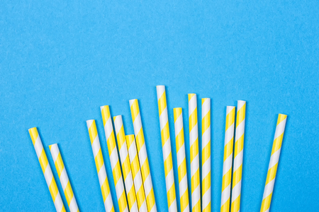 close-up colorful fancy drinking straws, fancy tube for party on the blue background Stock Photo