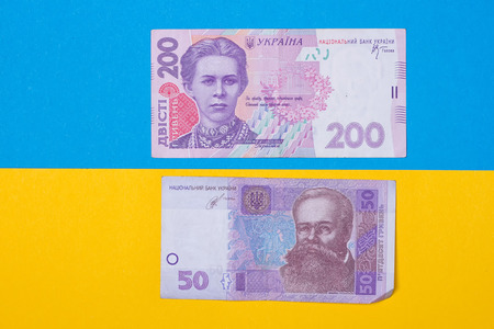 hryvna: money of Ukraine on the yellow and blue background