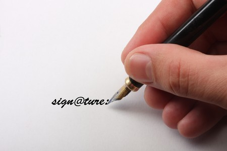part of hands signing a contract Stock Photo - 8072536