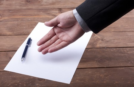 part of hands signing a contract Stock Photo - 8072973
