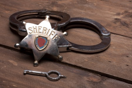 handcuffs: old sheriff badge and handcuffs
