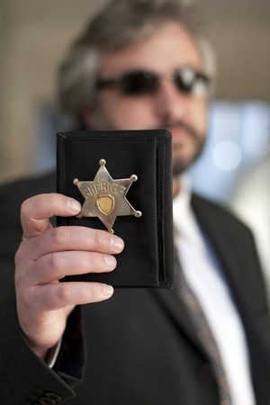 sheriff badge: Police officer show identification badge