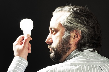 man holding a light bulb photo