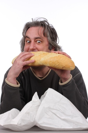 Young man eating big bread photo