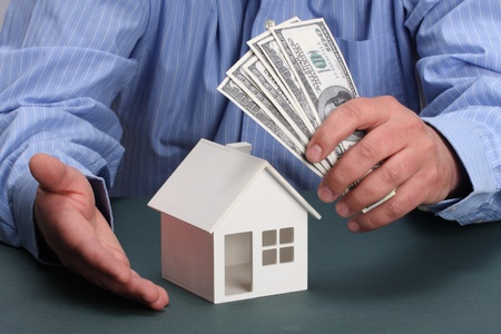 parts of hands with house and money Stock Photo - 8997978