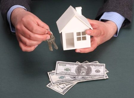 parts of hands with house and money Stock Photo - 8997972