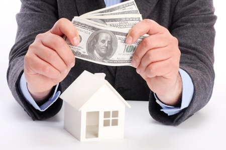 parts of hands with house and money Stock Photo - 8997958