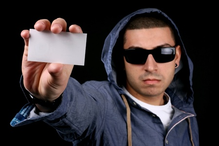 young man show business card Stock Photo - 9116540